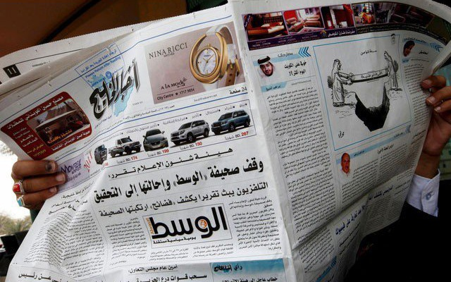 A man reads opposition newspaper Al-Wasat in Budaiya west of Manama, Bahrain in this April 3, 2011. Reuters File Photo