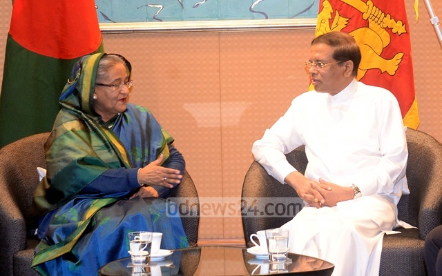 File Photo of Prime Minister Sheikh Hasina and Sri Lankan President Maithripala Sirisena during a meeting in Japan in May last year.