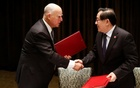 California Governor Jerry Brown and Chinese Minister of Science and Technology Wan Gang attend a signing ceremony at the International Forum on Electric Vehicle Pilot Cities and Industrial Development in Beijing, China Jun 6, 2017. Reuters