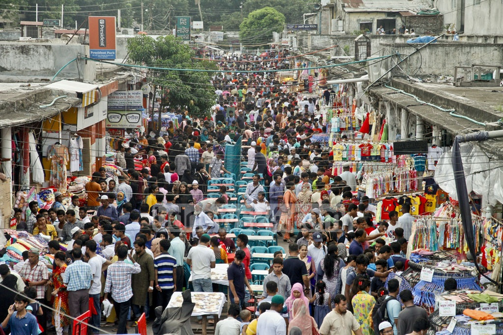 People descended on New Market on Friday, a weekly holiday, to buy clothes and accessories ahead of Eid.