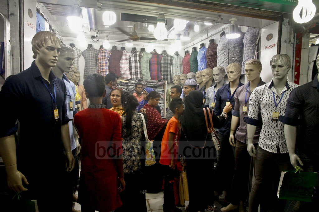 Many are browsing shops at New Market for new dresses.