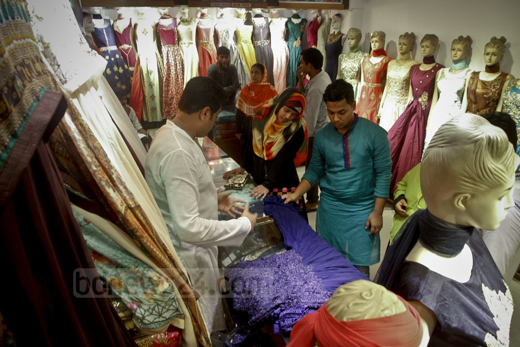 Customers checking dresses for Eid.