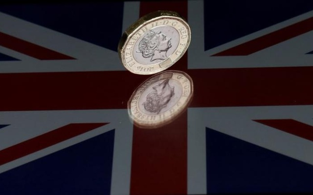 FILE PHOTO: A one pound coin lies on a Union Flag in this picture illustration shot on May 3, 2017. Reuters
