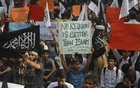 Representational Image: Protesters hold placards while they take part in an anti-American demonstration during a protest rally in Lahore on September 20, 2012. Some 2000 protesters gathered in a demonstration to condemn a film produced in the US mocking the Prophet Muhammad. Reuters