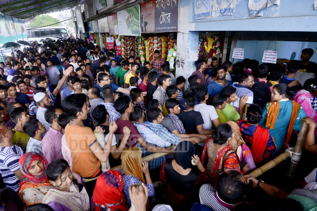 Women customers line up separately at a bus terminal in Dhaka's Gabtoli hoping to buy early tickets for Eid trips home. Photo: asaduzzaman pramanik