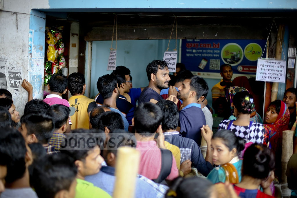 Customers wait in line for early Eid bus tickets at a bus terminal in Dhaka's Gabtoli. Photo: asaduzzaman pramanik