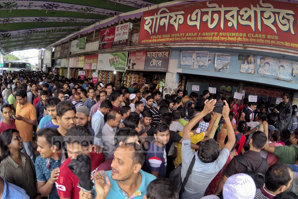 A large crowd gathers to buy early bus tickets for Eid trips at a counter in Gabtoli. Photo: asaduzzaman pramanik
