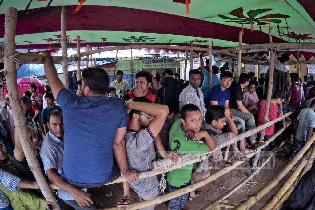 A large crowd gathers to buy early bus tickets for Eid trips at a counter in Kalyanpur. Photo: asaduzzaman pramanik