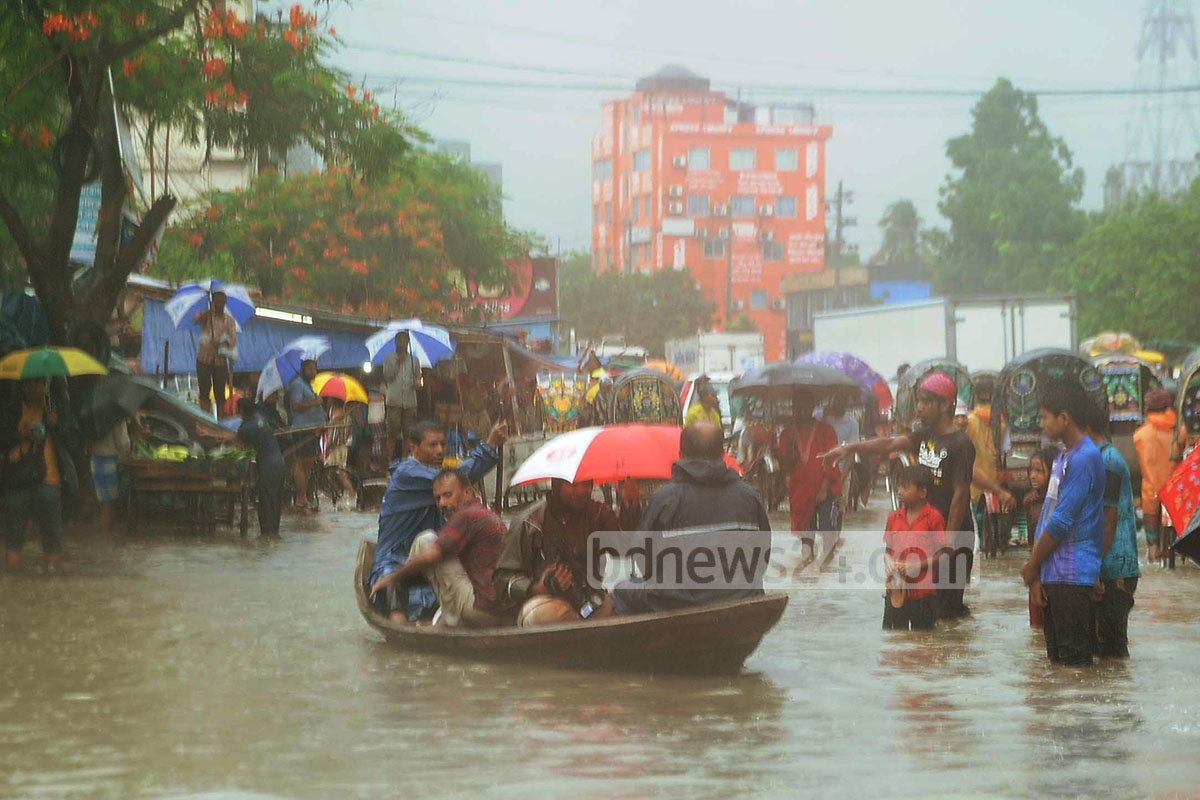 Boats are back as overnight rain sinks roads at low-lying parts of Chittagong on Monday. Photo taken from Agrabad Access Road. Photo: suman babu