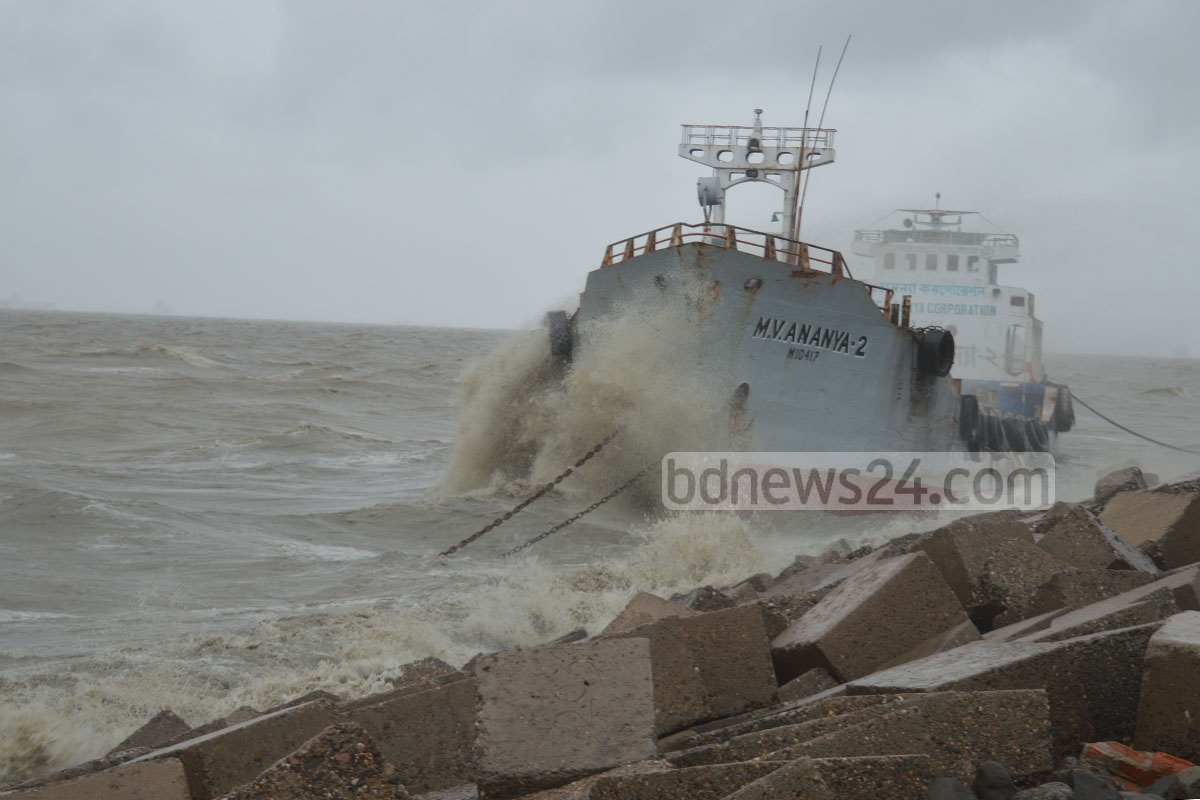 A ship drifts towards the embankment at Patenga after rough waves snapped its anchor on Monday. Photo: suman babu