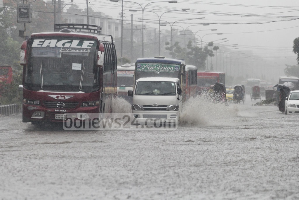 Cars spray water as they cross roads that looked more like canals after the rains on Monday. Photo taken at Mirpur's Chinese area. Photo: asif mahmud ove