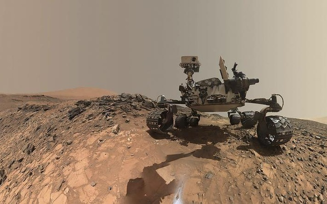 NASA's Curiosity Mars rover is seen at the site from which it reached down to drill into a rock target called 'Buckskin' on lower Mount Sharp in this low-angle self-portrait taken August 5, 2015. Reuters File Photo