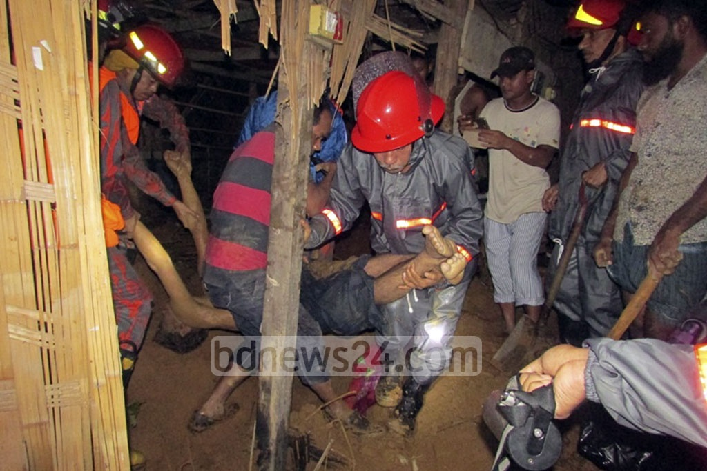 Fire service personnel trying to rescue victims affected by landslides in Bandarban. Heavy rains caused by a low pressure system in the Bay of Bengal led to the landslides in Rangamati, Chittagong and Bandarban on Tuesday.