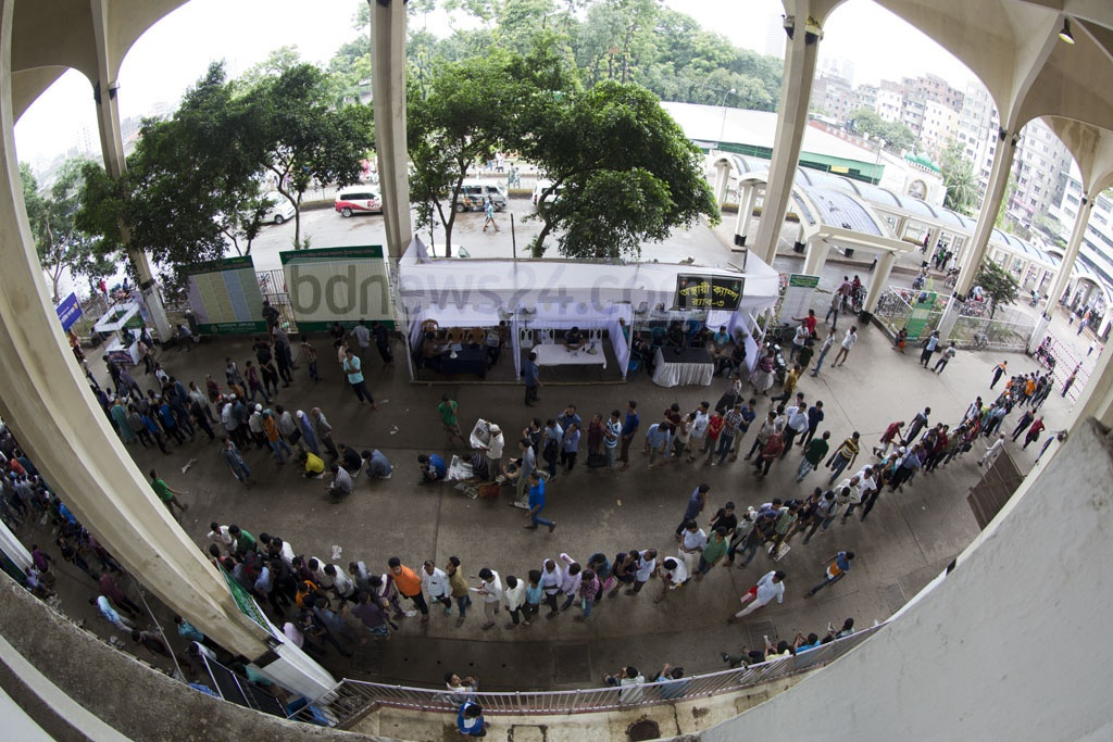 People queue up at Kamalapur Railway Station in the capital to avail tickets for their desired destinations prior to Eid-Ul-Fitr on Tuesday. Photo: mostafigur rahman