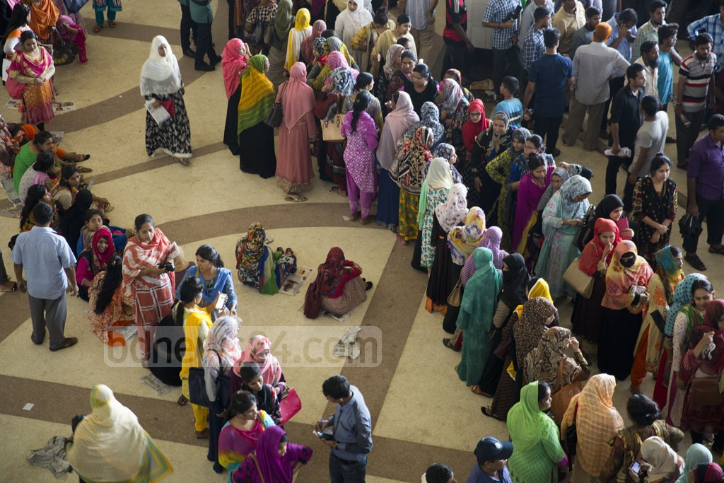 Women were put in separate queues at Kamalapur Railway Station in the capital on Tuesday, the second day in sale of advance tickets for Eid-Ul-Fitr. Photo: mostafigur rahman