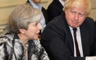 Britain's Prime Minister Theresa May sits next to Britain's Foreign Secretary Boris Johnson as she holds the first Cabinet meeting following the general election at 10 Downing Street, in London Jun 12, 2017. Reuters