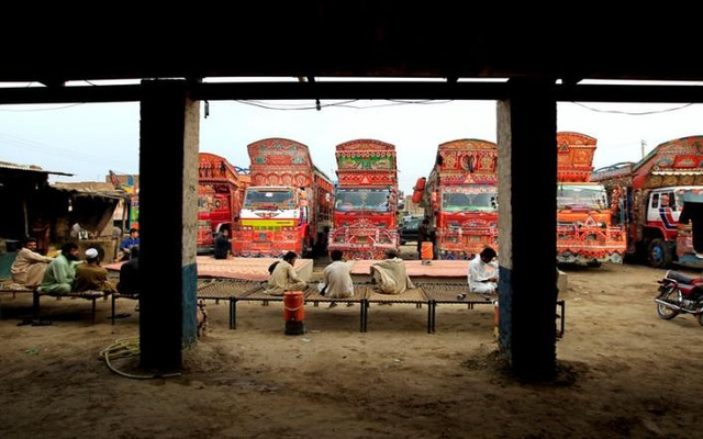 Drivers rest on beds at a truck stop outside Faisalabad, Pakistan, May 3, 2017. Reuters