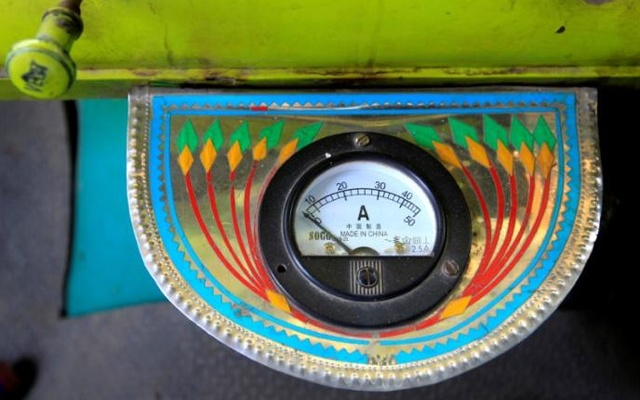 An electric gauge is seen in the cab of a decorated truck in Faisalabad, Pakistan, May 4, 2017. Reuters