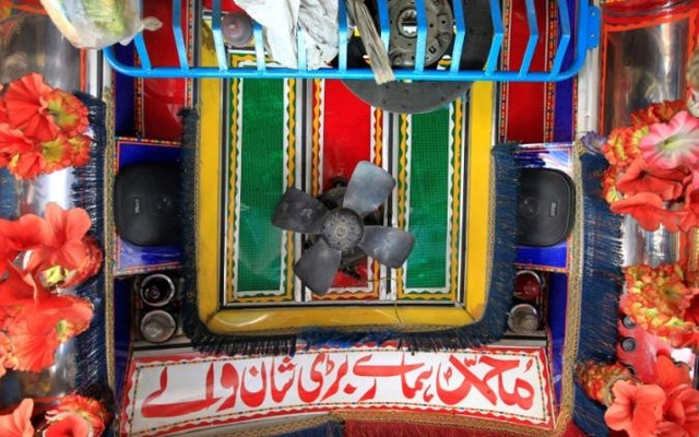 Speakers and a fan are seen in the cab of a decorated truck in Faisalabad, Pakistan, May 4, 2017. Reuters