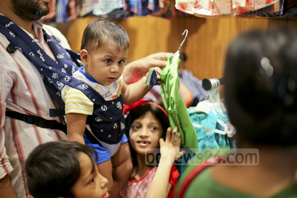 Children busy with Eid shopping. Photo: asaduzzaman pramanik