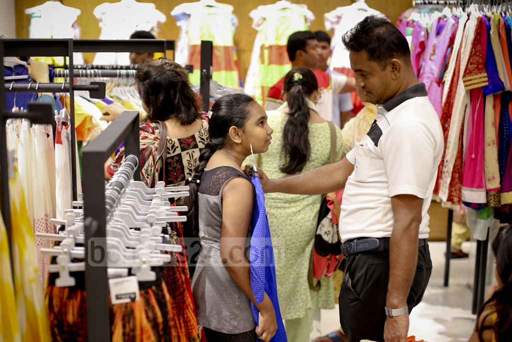 A child checks out dresses at Aarong's Bashundhara City outlet. Photo: asaduzzaman pramanik