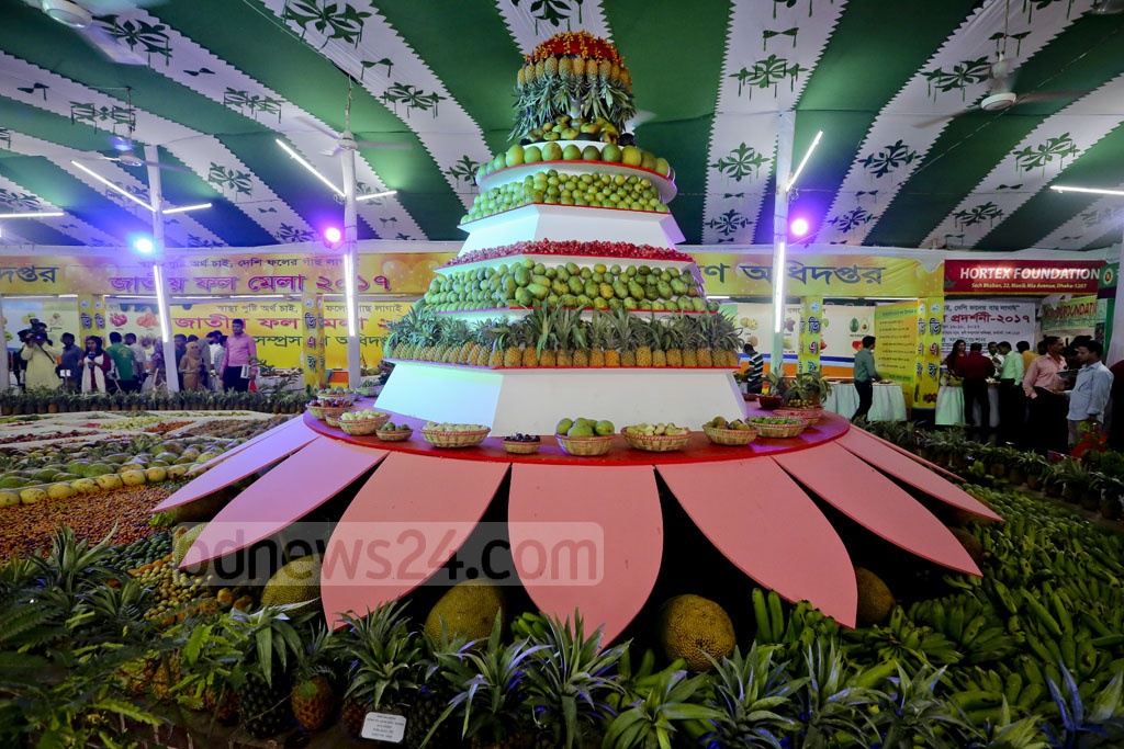 A pyramid structure decked with mangoes, jackfruits, pineapples and other summer fruits was displayed as the centrepiece of the National Fruit Fair that kicked off in Dhaka's Khamarbari on Friday. Photo: asaduzzaman pramanik