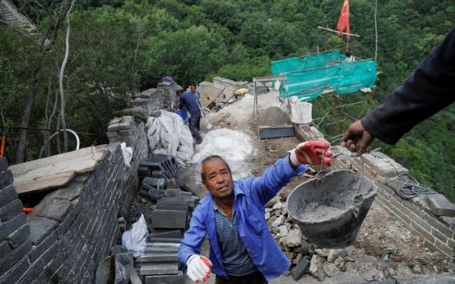 People work on the reconstruction of the Jiankou section of the Great Wall, located in Huairou District, north of Beijing, China, Jun 7, 2017. Reuters