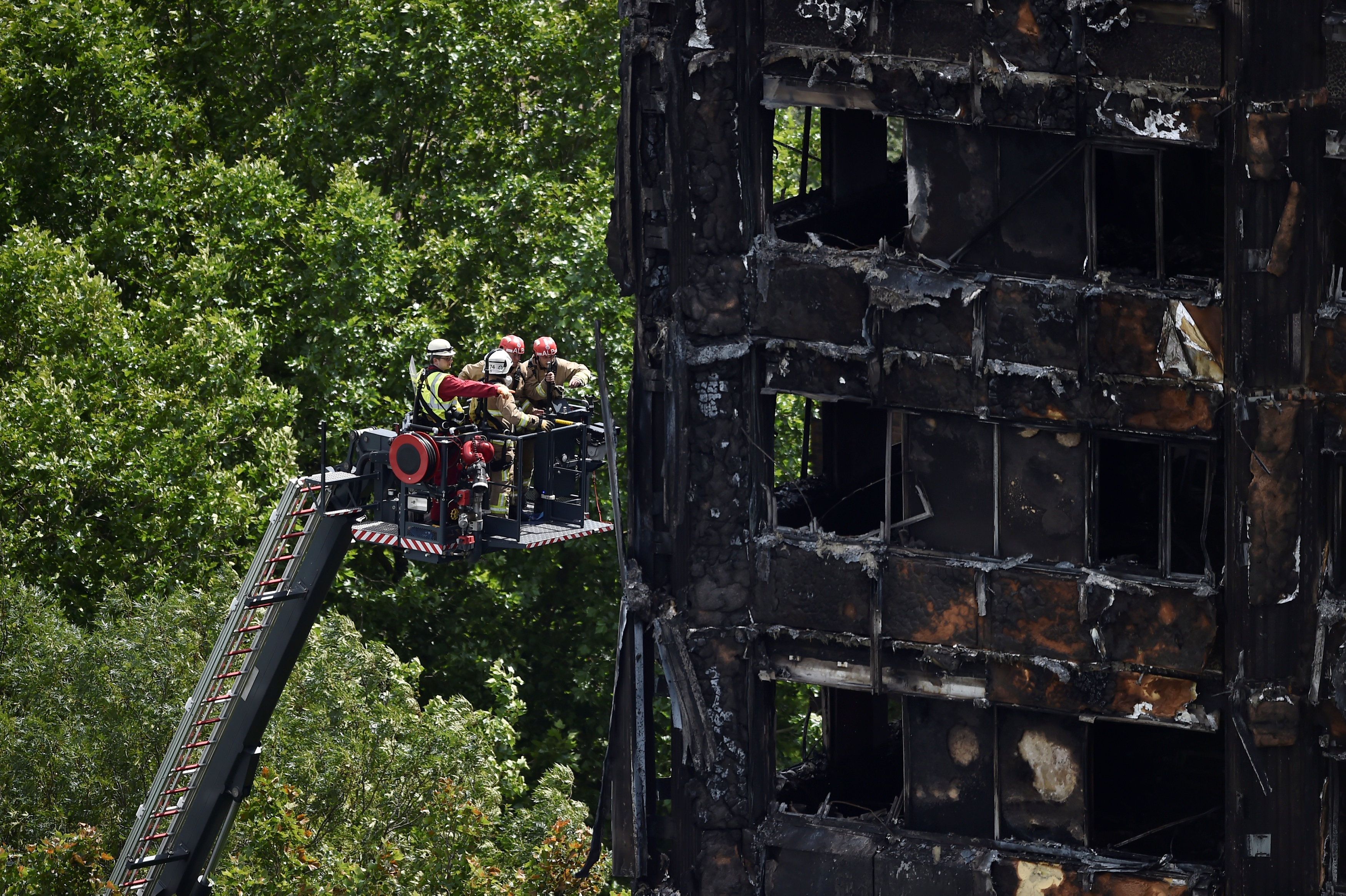 Firefighters at the Grenfell Tower block which was destroyed in a disastrous fire in London on June 16. Reuters