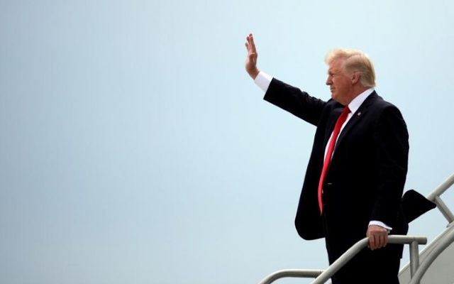 US President Donald Trump waves as he arrives at Miami International Airpot in Miami Florida US, Jun 16, 2017. Reuters