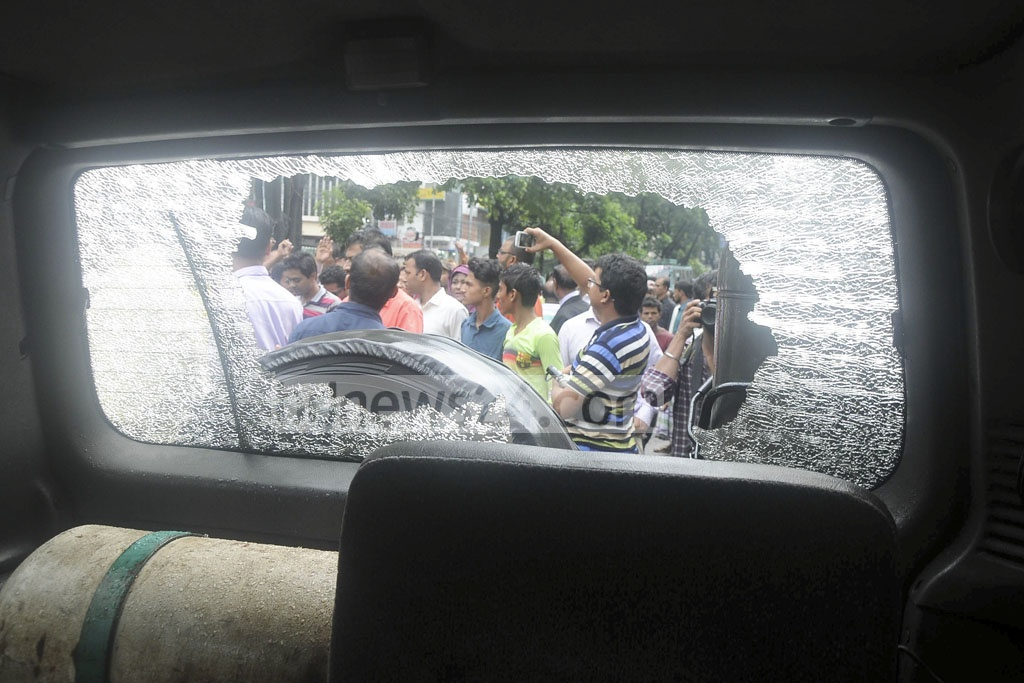 A vehicle carrying BNP leaders to Rangamati that came under attack by unknown assailants in Chittagong's Rangunia on Sunday. The photo was taken outside Chittagong Press Club, where the leaders held a briefing after they diverted back to Chittagong city.