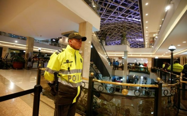 A police officer stands guard at an cordoned off area at the Andino shopping center after an explosive device detonated in a restroom, in Bogota, Colombia June 17, 2017. Reuters