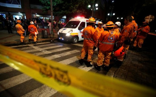Rescue personnel and an ambulance are seen behind yellow tape outside the Andino shopping centre after an explosive device detonated in a restroom, in Bogota, Colombia June 17, 2017. Reuters