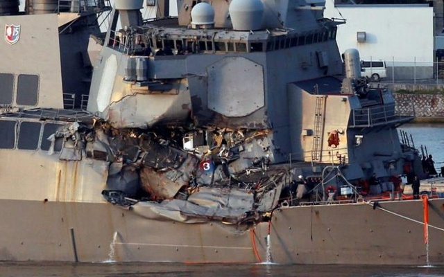 The Arleigh Burke-class guided-missile destroyer USS Fitzgerald, damaged by colliding with a Philippine-flagged merchant vessel, is towed into the US naval base in Yokosuka, south of Tokyo, Japan June 17, 2017. Reuters