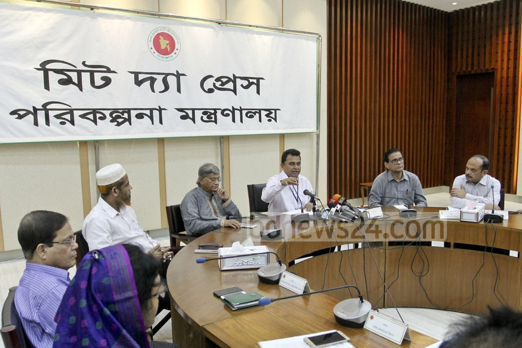 Planning Minister AHM Mustafa Kamal addresses a press conference at the Planning Commission in capital's Sher-e-Bangla Nagar on Monday.