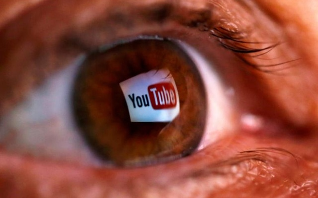 A picture illustration shows a YouTube logo reflected in a person's eye June 18, 2014. Reuters File Photo