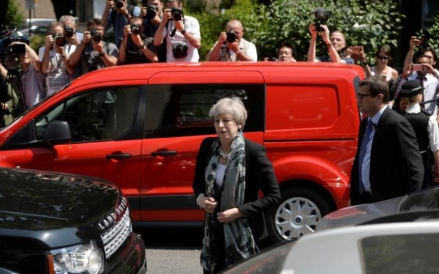 Britain's Prime Minister Theresa May arrives at the Finsbury Park Mosque after a van was driven at muslims outside the mosque in North London, Britain, June 19, 2017. Reuters