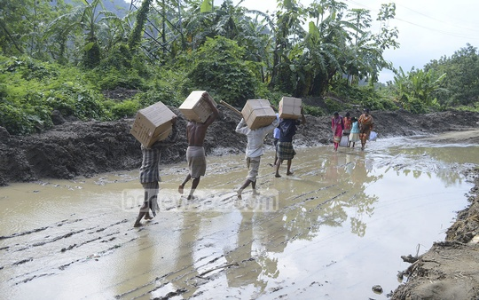 The Rangamati-Chittagong Highway runs over Shapchharhi. The road damaged by landslide is still blocked for vehicles but people have been passing on foot. Photo: suman babu