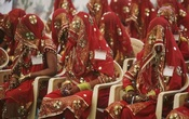 Brides wait for the start of their mass marriage ceremony in Ahmedabad November 20, 2011. REUTERS/Amit Dave/Files