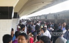 Trains failed to stay on schedule as people started heading home for Eid. The platform at Dhaka's Kamalapur Railway Station is seen packed with people waiting to board their trains. Photo: abdul mannan