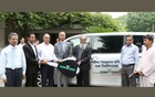 Md Habibur Rahman Mollah, executive director of Crown Cement, hands over a key of a new Toyota-branded microbus to Prof AAMS Arefin Siddique, vice-chancellor of Dhaka University, at a programme on Wednesday.