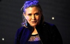 FILE PHOTO: Carrie Fisher poses for cameras as she arrives at the European Premiere of ''Star Wars, The Force Awakens'' in Leicester Square, London, December 16, 2015. Reuters