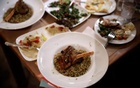 Traditional Syrian dishes are seen on a table during the Refugee Food Festival in Athens, Greece Jun 19, 2017. Reuters