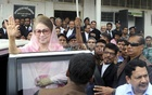 BNP chief Khaleda Zia waves at a crowd after reaching the special court set up at Old Dhaka's Bakshibazar where she was due to make a defence statement in Zia Charitable Trust graft case on Thursday.