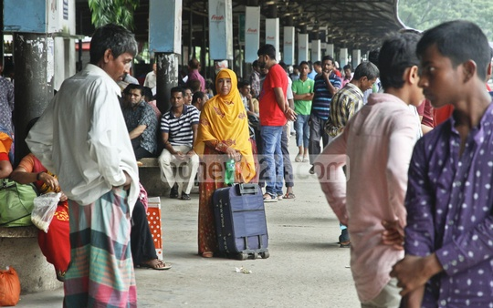 People at Dhaka's Airport Railway Station wait to catch trains to their hometowns before Eid. Photo: tanvir ahammed