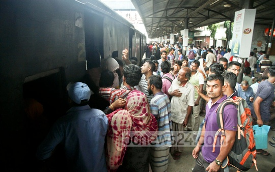 People start leaving Dhaka for their ancestral homes ahead of Eid. Picture taken at the Airport Railway Station. Photo: tanvir ahammed