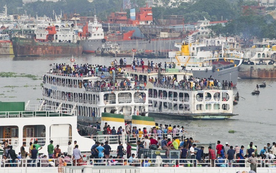 ​It is illegal to carry passengers on the roof of a launch, but no one seems to care about the rule as this photo testifies with the Eid holiday rush begining at Sadarghat terminal on Thursday.​ Photo: asif mahmud ove