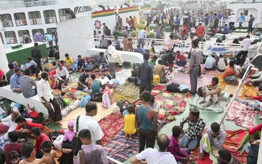 Many passengers occupy the roof of a launch at Sadarghat terminal as the Eid rush began on Thursday. Photo: asif mahmud ove