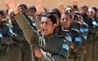Graduates of a US-trained police force, which expects to be deployed in Raqqa, salute during a graduation ceremony near Ain Issa village, north of Raqqa, Syria, Jun 17, 2017. Reuters