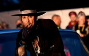 Actor Johnny Depp poses on a Cadillac before presenting his film The Libertine, at Cinemageddon at Worthy Farm in Somerset during the Glastonbury Festival in Britain, June 22, 2017. Reuters