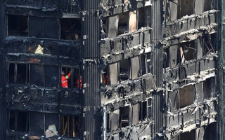 Members of the emergency services work inside burnt out remains of the Grenfell apartment tower in North Kensington, London, Britain. Photo: Reuters